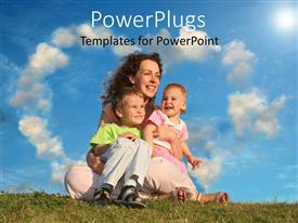 PowerPoint template displaying mother happy with her 2 kids sitting on grass cloudy background