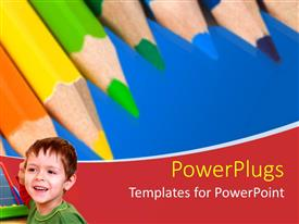 PowerPlugs: PowerPoint template with young boy ready to learn with school supplies in blue background