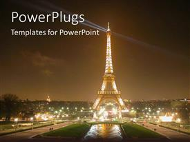 PowerPoint template displaying night view of the Effiel tower with light and a pond in front