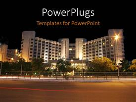 PowerPoint template displaying night view of a lighted high tower with a beautiful landscape