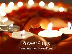 PowerPlugs: PowerPoint template with a number of burning candles with blurred background