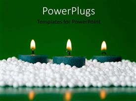 PowerPoint template displaying a number of candles with greenish background and place for text