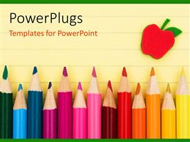 PowerPoint template displaying a number of color pencils with the drawing of an apple