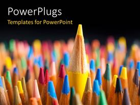 PowerPlugs: PowerPoint template with a number of color pencils with a yellow one on top and blackish background