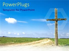 PowerPlugs: PowerPoint template with old wooden cross in country side with green vegetation and cloudy sky