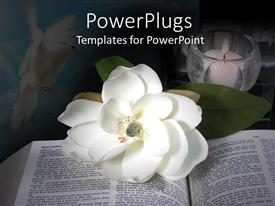 PowerPoint template displaying open book with white flower and candle in a cup