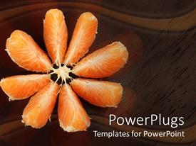 PowerPoint template displaying open orange slices on wooden reflective surface, brown background