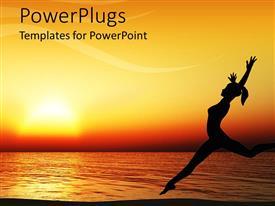 Beautiful PowerPoint having orange sunset behind woman dancing on beach