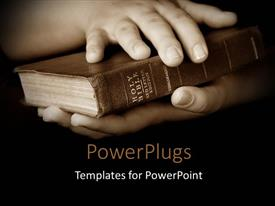 PowerPlugs: PowerPoint template with pair hands holding well read Holy Bible