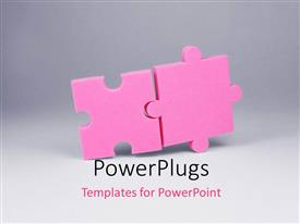 PowerPoint template displaying a pair of puzzle pieces with grayish background