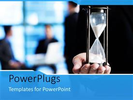 PowerPlugs: PowerPoint template with a person holding the sand glass with blurred background