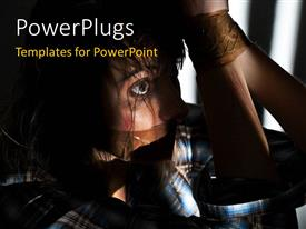PowerPlugs: PowerPoint template with a person trying to hide the face in a jail