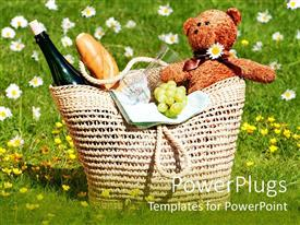 PowerPoint template displaying picnic basket with teddy bear, bread, wine, glasses, grapes in meadow with flowers