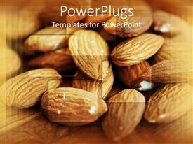 PowerPlugs: PowerPoint template with pile of almonds on a brown background wooden surface