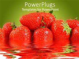 PowerPoint template displaying piled up fresh strawberries in water with a green background