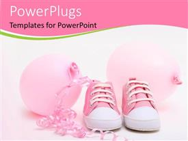 PowerPoint template displaying pink shoes and balloons for a newborn girl
