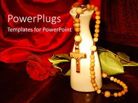 PowerPlugs: PowerPoint template with praying beads with a rose and vase on a red cloth