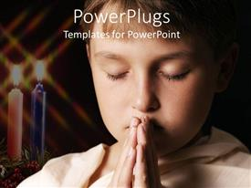PowerPlugs: PowerPoint template with praying child with eyes closed next to two burning candles