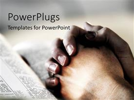 PowerPlugs: PowerPoint template with praying reading the bible clasped hands as a metaphor for faith