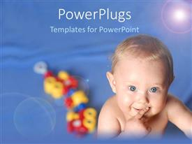 PowerPoint template displaying pretty baby with blue eyes smiling on a blue background