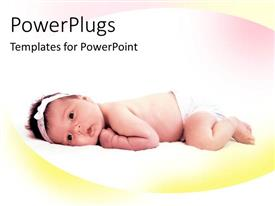 PowerPoint template displaying pretty little baby lying face down on a soft surface