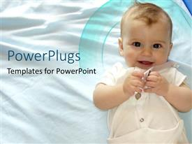 PowerPoint template displaying pretty smiling little happy baby on a white sheet