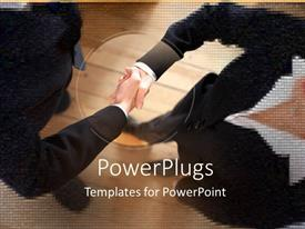 PowerPoint template displaying a professional handshake with wooden background