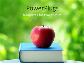 PowerPlugs: PowerPoint template with red apple on blue colored book with green background