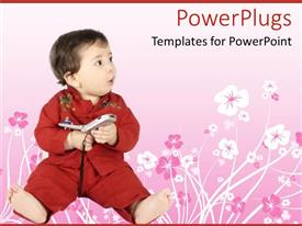PowerPoint template displaying red clothing baby with a surprised look on face playing with mobile phone on floral patterned pink background