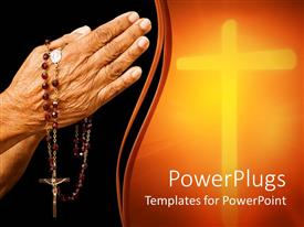 PowerPlugs: PowerPoint template with religious depiction of old woman hands in prayer holding rosary with Jesus on cross, glowing cross in light