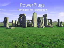 PowerPoint template displaying the repreentation of stonehenge with a lot of greenery