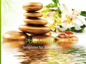 PowerPoint template displaying rings placed on spa stones near water with lilies in background