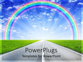 PowerPlugs: PowerPoint template with road through green field leading towards light rays and rainbow on bright sky background