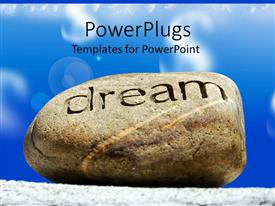PowerPlugs: PowerPoint template with rock with word DREAM inscribed with blue cloudy sky