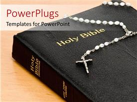 PowerPlugs: PowerPoint template with rosary on Holy Bible sitting on wooden table