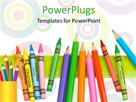 PowerPlugs: PowerPoint template with row of colorful crayons on green ruler with circles in background