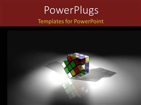 PowerPlugs: PowerPoint template with a rubix cube under a spot light on a white background