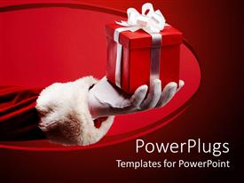 PowerPlugs: PowerPoint template with sant clause hand holding a boxed red gift with ribbons