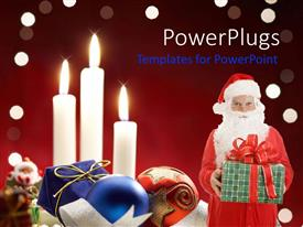 PowerPoint template displaying santa Claus holding gift next to Christmas decorations and three burning white candles