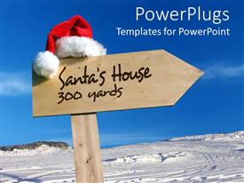PowerPlugs: PowerPoint template with sign pointing way to Santa's house with snowy background and clear blue sky