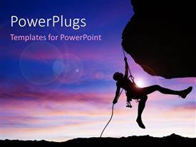 PowerPlugs: PowerPoint template with silhouette of climber hanging by rope from rock face just before sunset