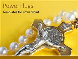 PowerPlugs: PowerPoint template with silver Jesus on gold cross with pearls on yellow background