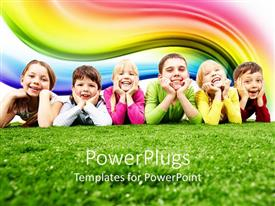 PowerPoint template displaying six happy kids, three girls and three boys lying on green grass smiling happy at the camera with rainbow in the background