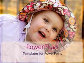 PowerPoint template displaying smiling baby girl wearing hat with floral prints on paneled background