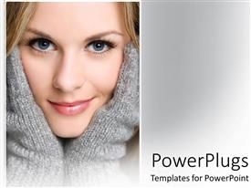 PowerPlugs: PowerPoint template with smiling woman wearing gray mitten gloves in gray background