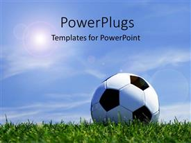 PowerPlugs: PowerPoint template with soccer ball on grass depicting sports concept with beautiful blue sky