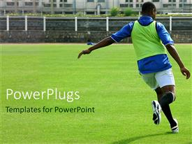 PowerPlugs: PowerPoint template with soccer player on green grassy field playing soccer on empty playground