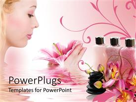 PowerPoint template displaying spa stones, pink lotion tubes and woman holding beauty flower