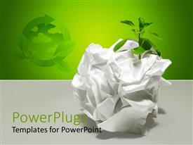 PowerPlugs: PowerPoint template with a squeezed piece of white colored paper with a plant in it