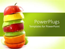 PowerPlugs: PowerPoint template with stack of freshly cut red, yellow and green apples and oranges on green background